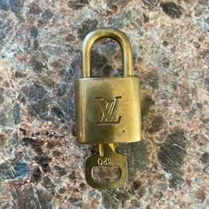 Louis Vuitton authentic lock and key LV